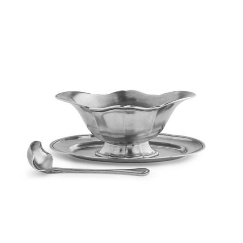 "Arte Italica Tavola Gravy Boat with Tray and Ladle TAV6729  Tavola, meaning table in Italian, incorporates all the essentials needed to dress and serve the table. Don't limit this beautiful gravy boat to only gravy, use it to serve salad dressings, sauces, chutney and other favorites. The boat sits on an oval dish and comes with a ladle. Italian pewter, Hand made in Italy. Hand wash only.  8.25""L X 5"" W X 3.25"" H"
