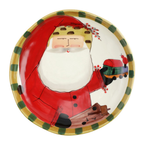"""Vietri Old St Nick Round Shallow Bowl with Train  OSN-78103  13.5""""D, 3""""H     What could be more whimsical than the individual portraits of Vietri's Old St. Nick, beloved by all Italians!     Each Santa is created for Vietri from maestro Alessandro Taddei's childhood memories of stories his mother read to him. Made of terra bianca, each portrait is painted directly on the fired surface in Tuscany so that each stroke is seen in detail."""
