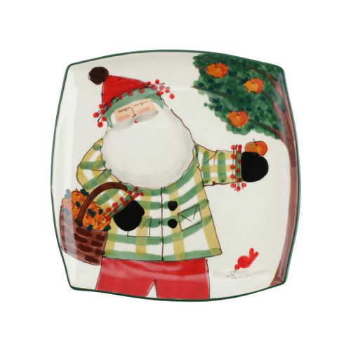 """Vietri Old St Nick Square Platter with Apples  OSN-78104  12"""" Sq     What could be more whimsical than the individual portraits of Vietri's Old St. Nick, beloved by all Italians!     Each Santa is created for Vietri from maestro Alessandro Taddei's childhood memories of stories his mother read to him. Made of terra bianca, each portrait is painted directly on the fired surface in Tuscany so that each stroke is seen in detail."""