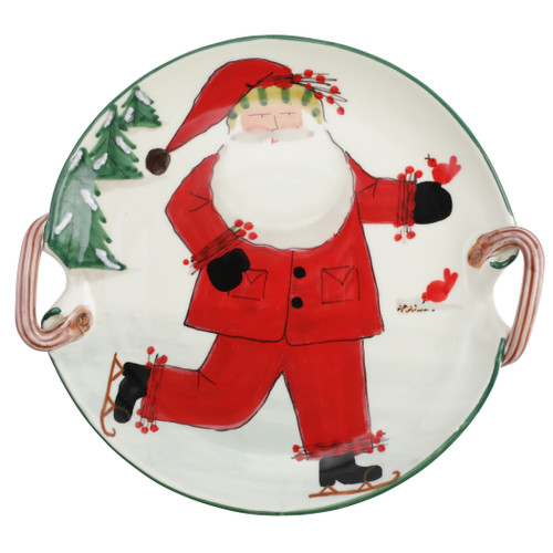 "Vietri Old St Nick Handled Round Platter Ice Skating  OSN-78102  15.25"" D     What could be more whimsical than the individual portraits of Vietri's Old St. Nick, beloved by all Italians!     Each Santa is created for Vietri from maestro Alessandro Taddei's childhood memories of stories his mother read to him. Made of terra bianca, each portrait is painted directly on the fired surface in Tuscany so that each stroke is seen in detail."