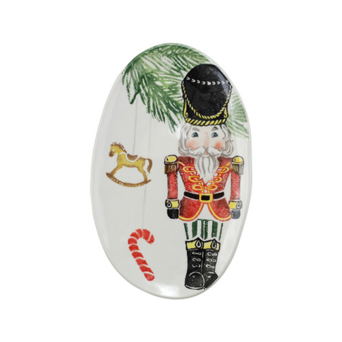 "Vietri Nutcrackers Small Oval Platter Gift Boxed  NTC-9724-GB 12.5""L, 8.25""W  Maestro artisan, Gianluca Fabbro, recreates a Christmas classic with bright colors and a cheerful holiday design inspiring new family traditions with handpainted collectibles. Handpainted on terra bianca in Veneto. Dishwasher and microwave safe."