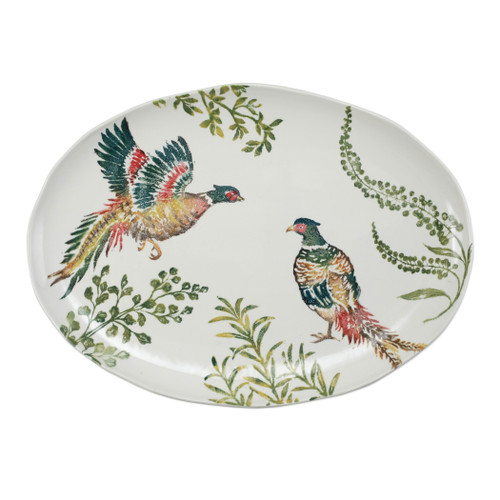 """Vietri Fauna Pheasants Large Oval Platter  FAU-9726 21.75""""L. 15.5""""W  The work of maestro artisan, Gianluca Fabbro, is often recognized by a bold array of colors coupled with an innate attention to detail through his handpainted sponging technique. Fauna combines the outline of the classic hunting bird paired with nature's greenery to depict what is commonly found during the hunt (la caccia) in Umbria, the Italian land known for capturing wild pheasants. Dishwasher and microwave safe."""