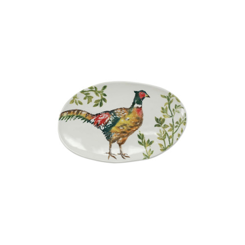 """Vietri Fauna Pheasants Small Oval Platter  FAU-9724 12.5""""L. 8.25""""W  The work of maestro artisan, Gianluca Fabbro, is often recognized by a bold array of colors coupled with an innate attention to detail through his handpainted sponging technique. Fauna combines the outline of the classic hunting bird paired with nature's greenery to depict what is commonly found during the hunt (la caccia) in Umbria, the Italian land known for capturing wild pheasants. Dishwasher and microwave safe."""