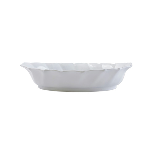 """Vietri Incanto Ruffled Oval Baker  INC-11062 15.25""""L, 10""""W, 2.5""""H The waves of the Adriatic Sea are elegantly recreated on the surface of the Incanto Ruffle Handled Oval Baker. Handcrafted in Veneto, this piece translates flawlessly from a summertime soirée to a casual dinner for two."""