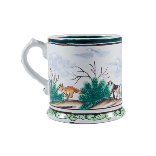 C.E. Corey Century Hunt 14oz Footed Mug  14oz A116I  A truly magnificent and whimsical fox hunt scene. The pattern is done using the Century-Style Painting technique developed by artisans in Portugal. Each piece is a true work of art, handmade, hand-painted and signed.