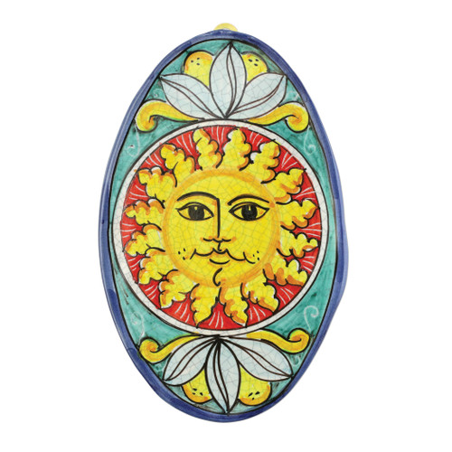"Vietri First Stones Oval Sun Wall Plaque  FTS-9103 11""L, 7""W  A VIETRI Classic, First Stones are rich in allegorical representation and bring good wishes and serenity to your home indoors and outdoors with handpainted vibrant colors characteristic of Sicilian culture and its historical identity.  Handpainted on terra cotta in Sicily. Wipe with damp cloth to clean."