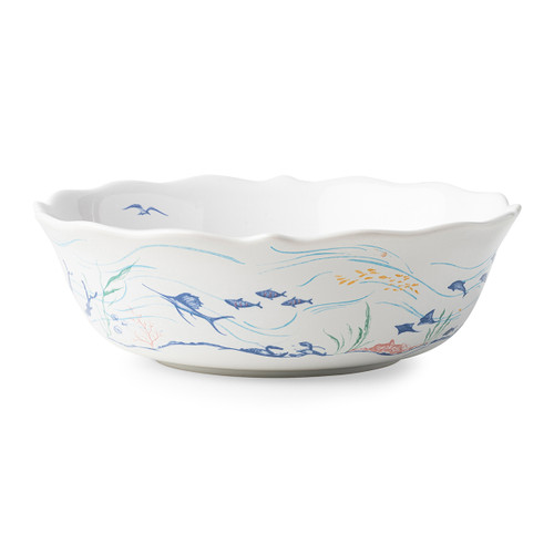"""Juliska Country Estate Seaside 10"""" Serving Bowl  CE31X/88 10""""D, 3""""H  Juliska's Country Estate residents go on Holiday to the English seaside.  Read a book on the beach under an umbrella, set sail on the ocean, soak in the sun on the lifeguard stand or go fishing off the pier.  Then dive into the water and explore the beautiful sea life on the scallop dinner plate and serving bowl. Each piece features unique artwork in a sun washed pallet of pastel hues.  Made in Portugal. Dishwasher, freezer, microwave and oven safe."""