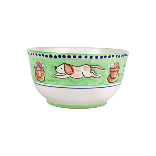 """Vietri Cane Deep Serving Bowl CNE-1042 10.25"""" Diameter, 5.25""""H  Part of Vietri's premiere dinnerware line from the famed Amalfi Coast, Campagna from plumpuddingkitchen.com offers endless possibilities for artistic entertaining when mixed with solids or the other colorful patterns that capture the vitality of the Italian countryside. The newest design, Cane, features whimsical handpainted pups playfully running through a seaside garden in Positano.  Translation: dog Handmade of terra cotta in Campania Part of the Campagna Collection, VIETRI's very first dinnerware collection introduced in 1983! Dishwasher safe"""