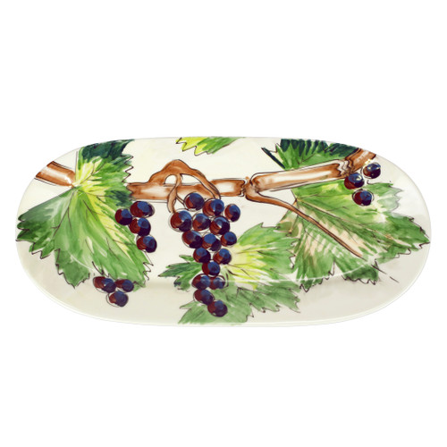 """Vietri Cantina Small Oval Platter  CNT-7877 16.75""""L, .5""""  The harvesting of grapes to make wine, a long sought after tradition in Italy, is beautifully reflected in the handpainted scenes of Cantina from plumpuddingkitchen.com. Handpainted on terra bianca in Tuscany. Dishwasher safe."""