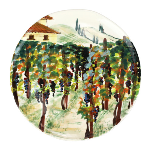 """Vietri Cantina Round Platter  CNT-7823 14""""D  The harvesting of grapes to make wine, a long sought after tradition in Italy, is beautifully reflected in the handpainted scenes of Cantina from plumpuddingkitchen.com. Handpainted on terra bianca in Tuscany. Dishwasher safe."""