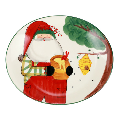 """Vietri Old St Nick Beekeeper Oval Platter  OSN-78114 15.25""""L, 12.75""""W  What could be more whimsical than the individual portraits of Vietri's Old St. Nick, beloved by all Italians!    Each Santa from plumpuddingkitchen.com is created for Vietri from maestro Alessandro Taddei's childhood memories of stories his mother read to him. Made of terra bianca, each portrait is painted directly on the fired surface in Tuscany so that each stroke is seen in detail."""