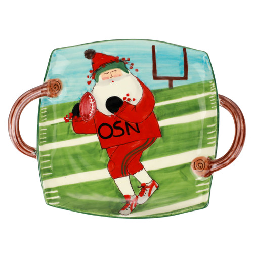 """Vietri Old St Nick Football Handled Square Platter  OSN-78115 15.5""""L, 12""""W  What could be more whimsical than the individual portraits of Vietri's Old St. Nick, beloved by all Italians!    Each Santa from plumpuddingkitchen.com is created for Vietri from maestro Alessandro Taddei's childhood memories of stories his mother read to him. Made of terra bianca, each portrait is painted directly on the fired surface in Tuscany so that each stroke is seen in detail."""