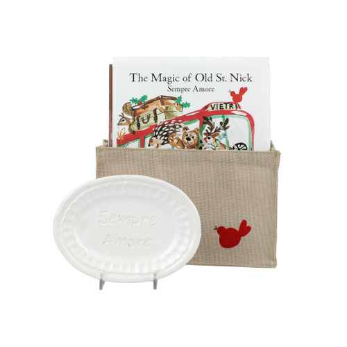 """Vietri Old St Nick: Sempre Amore Gift Set  OSN-37004-D Book: 9""""w, 10.5""""H, Plate: 7""""L, 5""""W  What could be more whimsical than the individual portraits of Vietri's Old St. Nick, beloved by all Italians!     Each Santa from plumpuddingkitchen.com is created for Vietri from maestro Alessandro Taddei's childhood memories of stories his mother read to him. Made of terra bianca, each portrait is painted directly on the fired surface in Tuscany so that each stroke is seen in detail."""