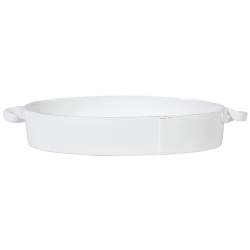 """The Lastra White Handled Oval Baker is an irresistibly elegant piece in which to cook. An overlapping wooden mold, used for centuries to form cheeses throughout Italy, inspired this collection. 15.5""""L, 5.75""""W, 3""""H LAS-2655W"""