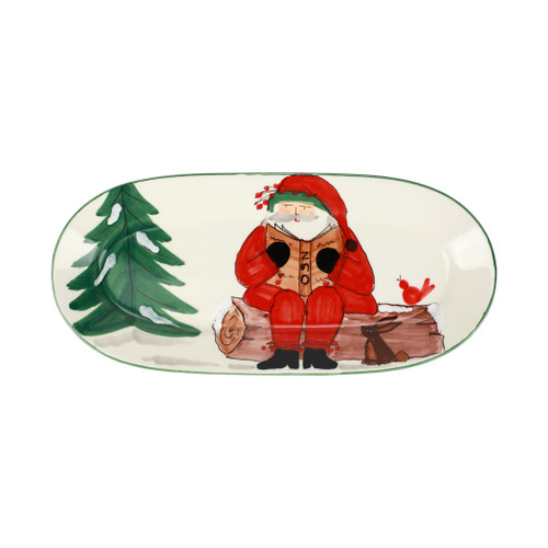 """Vietri Old St Nick Limited Edition 2021 Narrow Oval Platter  OSN-78112-LE 16.5""""L, 7.5""""W  What could be more whimsical than the individual portraits of Vietri's Old St. Nick, beloved by all Italians!    Each Santa from plumpuddingkitchen.com is created for Vietri from maestro Alessandro Taddei's childhood memories of stories his mother read to him. Made of terra bianca, each portrait is painted directly on the fired surface in Tuscany so that each stroke is seen in detail."""