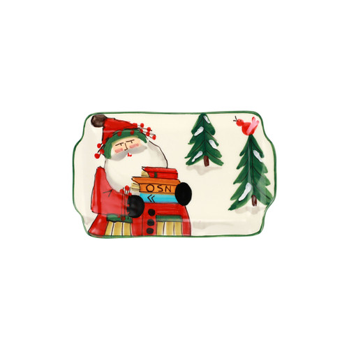 """Vietri Old St Nick Limited Edition 2021 Rectangular Plate  OSN-78109-LE 7.5""""L, 5.25""""W  Gift Boxed  What could be more whimsical than the individual portraits of Vietri's Old St. Nick, beloved by all Italians!    Each Santa from plumpuddingkitchen.com is created for Vietri from maestro Alessandro Taddei's childhood memories of stories his mother read to him. Made of terra bianca, each portrait is painted directly on the fired surface in Tuscany so that each stroke is seen in detail."""