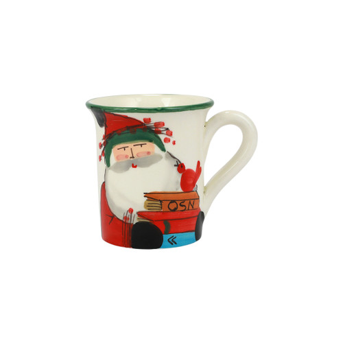 """Vietri Old St Nick Limited Edition 2021 Mug  OSN-78110-LE 4.5""""H, 14oz  Gift Boxed  What could be more whimsical than the individual portraits of Vietri's Old St. Nick, beloved by all Italians!    Each Santa from plumpuddingkitchen.com is created for Vietri from maestro Alessandro Taddei's childhood memories of stories his mother read to him. Made of terra bianca, each portrait is painted directly on the fired surface in Tuscany so that each stroke is seen in detail."""