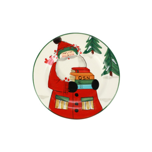 """Vietri Old St Nick Limited Edition 2021 Salad Plate  OSN-78108-LE 8.5""""D  Gift Boxed  What could be more whimsical than the individual portraits of Vietri's Old St. Nick, beloved by all Italians!    Each Santa from plumpuddingkitchen.com is created for Vietri from maestro Alessandro Taddei's childhood memories of stories his mother read to him. Made of terra bianca, each portrait is painted directly on the fired surface in Tuscany so that each stroke is seen in detail."""