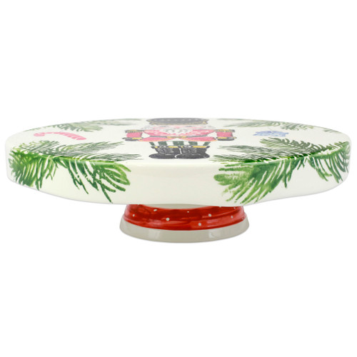 """Vietri Nutcrackers Cake Stand  NTC-9773 12.5""""D, 3.5""""H  Maestro artisan, Gianluca Fabbro, recreates a Christmas classic with bright colors and a cheerful holiday design inspiring new family traditions with handpainted collectibles. Handpainted on terra bianca in Veneto. Dishwasher and microwave safe."""