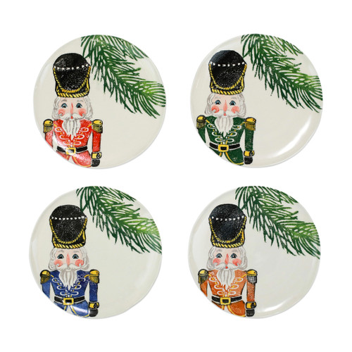 """Vietri Nutcrackers Assorted Salad Plates Set/4  NTC-9701 9""""D  Maestro artisan, Gianluca Fabbro, recreates a Christmas classic with bright colors and a cheerful holiday design inspiring new family traditions with handpainted collectibles from plumpuddingkitchen.com. Handpainted on terra bianca in Veneto. Dishwasher and microwave safe."""