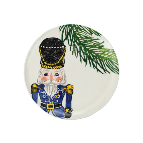 """Vietri Nutcrackers Blue Salad Plate  NTC-9701C 9""""D  Maestro artisan, Gianluca Fabbro, recreates a Christmas classic with bright colors and a cheerful holiday design inspiring new family traditions with handpainted collectibles from plumpuddingkitchen.com. Handpainted on terra bianca in Veneto. Dishwasher and microwave safe."""