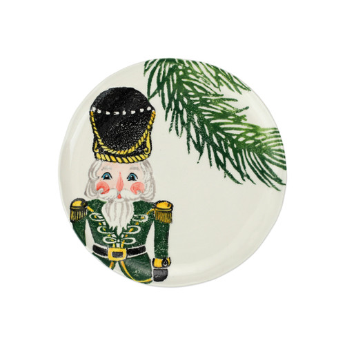 """Vietri Nutcrackers Green Salad Plate  NTC-9701B 9""""D  Maestro artisan, Gianluca Fabbro, recreates a Christmas classic with bright colors and a cheerful holiday design inspiring new family traditions with handpainted collectibles from plumpuddingkitchen.com. Handpainted on terra bianca in Veneto. Dishwasher and microwave safe."""