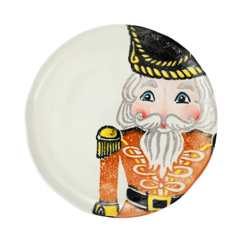 """Vietri Nutcrackers Gold Dinner Plate  NTC-9700D 11.5""""D  Maestro artisan, Gianluca Fabbro, recreates a Christmas classic with bright colors and a cheerful holiday design inspiring new family traditions with handpainted collectibles from plumpuddingkitchen.com.Handpainted on terra bianca in Veneto. Dishwasher and microwave safe."""