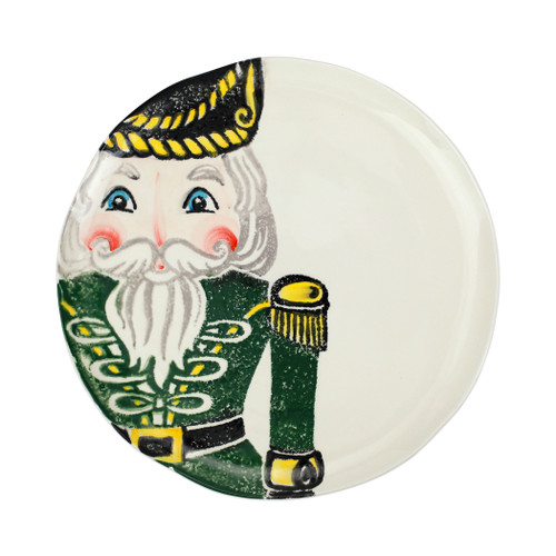 """Vietri Nutcrackers Green Dinner Plate  NTC-9700B 11.5""""D  Maestro artisan, Gianluca Fabbro, recreates a Christmas classic with bright colors and a cheerful holiday design inspiring new family traditions with handpainted collectibles from plumpuddingkitchen.com.Handpainted on terra bianca in Veneto. Dishwasher and microwave safe."""