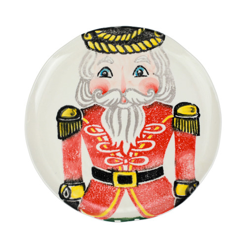 """Vietri Nutcrackers Red Dinner Plate  NTC-9700A 11.5""""D  Maestro artisan, Gianluca Fabbro, recreates a Christmas classic with bright colors and a cheerful holiday design inspiring new family traditions with handpainted collectibles from plumpuddingkitchen.com.Handpainted on terra bianca in Veneto. Dishwasher and microwave safe."""