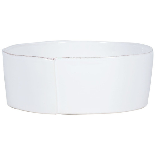 "The Lastra White Large Serving Bowl features rustic, sculptural edges, and an overlapping wooden mold, used for centuries to form cheeses throughout Italy, inspired this collection. 10.75""D, 4""H LAS-2632W"