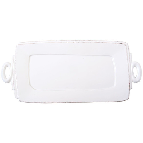 """The Lastra White Handled Rectangular Platter brings crisp, rustic elegance into your home. An overlapping wooden mold, used for centuries to form cheeses throughout Italy, inspired this collection. 16""""L, 8.75""""W LAS-2623W"""