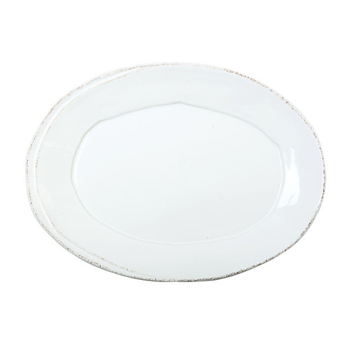 """The Lastra White Small Oval Platter is a sophisticated shape to bring to your table. An overlapping wooden mold, used for centuries to form cheeses throughout Italy, inspired this collection. 13.5""""L, 10""""W LAS-2625W"""
