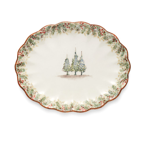 """Arte Italica Natale Scalloped Oval Platter  NAT6839  Natale is the perfect collection to entertain through the winter season. Berries and pine boughs surround the snowy evergreens. Our Natale Oval Platter is perfect for entertaining, use it to serve up holiday favorites. Hand made in Italy.  Microwaveable (may get hot) and dishwasher safe on the low heat, air-dry setting.  15"""" L X 12"""" W X 1.25"""" H"""