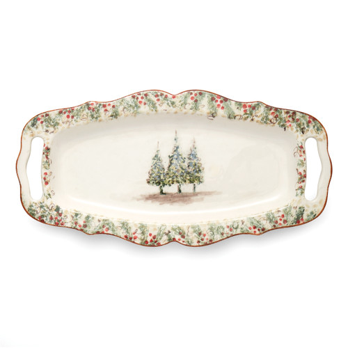 """Arte Italica Natale Large Rectangular Tray with Handles  NAT6838  Natale is the perfect collection to entertain through the winter season. Berries and pine boughs surround the snowy evergreens. Our Natale Long Rectangular Tray is perfect for entertaining, use it to serve up holiday favorites. Hand made in Italy.  Microwaveable (may get hot) and dishwasher safe on the low heat, air-dry setting.  17.5"""" L x 8.75"""" W"""