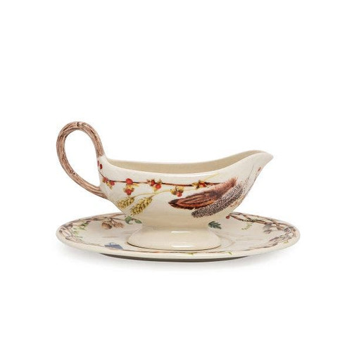 """Juliska Forest Walk Sauce Boat and Stand  CW32SET/90 10.25""""L, 725""""W, 5.5""""H 13oz  This Forest Walk sauce boat from plumpuddingkitchen.com is perfectly suited to house your most mouthwatering gravies and decadent sauces. With a gorgeous faux-wood handle and deilghtful woodland accents scattered across both pieces, this set will serve as a mini centerpiece anywhere it lands on the table."""