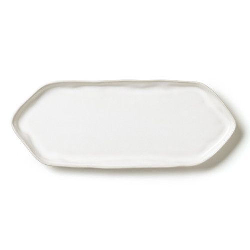 """The Forma Cloud Rectangular Platter with Triangular Edges, made of the strongest stoneware, has both a simple and striking shape. Handformed in Veneto, this platter works wonderfully as a serving piece (try it as a cheese plate) and a decorative piece (we love it for jewelry) alike. We also like it as a sushi platter paired with the dipping bowls for soy sauce. 13.25""""L, 5.25""""W FOM-1127CL"""