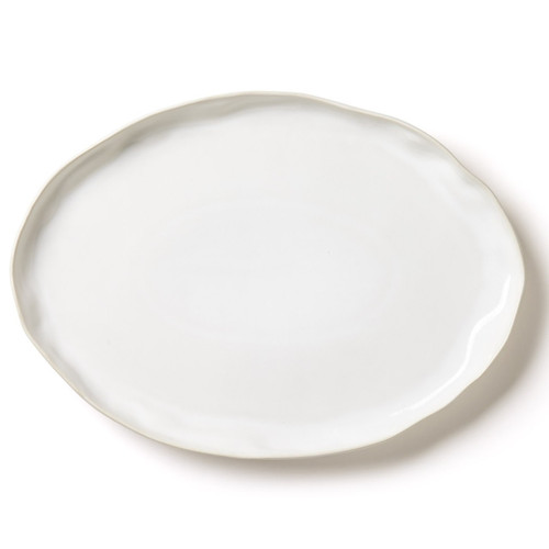 """The Forma Cloud Large Oval Platter is handformed from the strongest stoneware in Veneto, Italy. With authentic, unique edges and its ample, easy shape, this serving piece makes a simple and sophisticated statement. 18""""L, 12.75""""W, 1.5""""H FOM-1126CL"""
