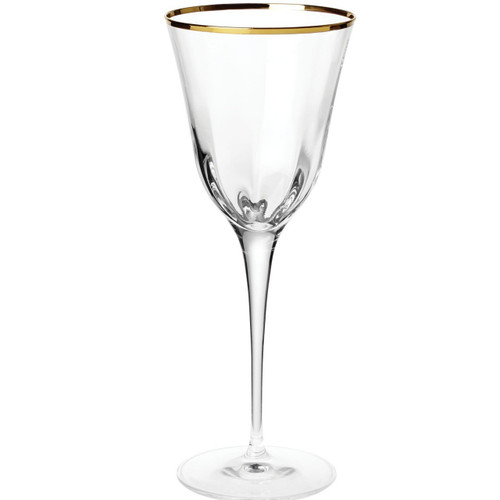 "The Optical Gold Wine Glass is trimmed in a delicate gilded rim, and its elegant lines bring sophistication and glamour to every table. The golden embellishment is effortlessly beautiful. 9""H, 9 oz OPG-8820"