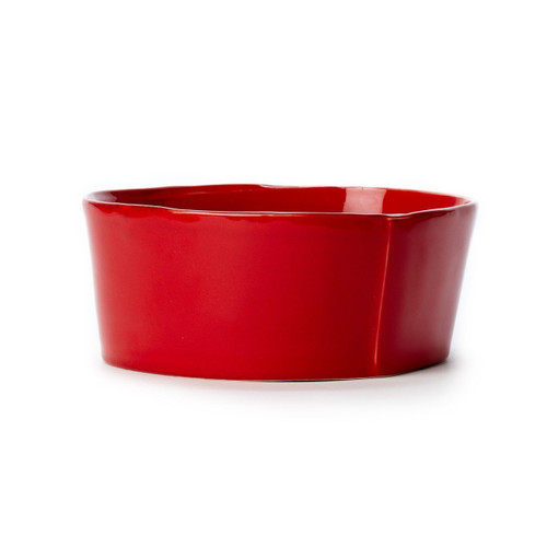 "Long lauded for creating one of the best shades of red in tabletop, we are thrilled to announce our newest red. Lastra's iconic cheese mold shape meets the rich hue, and the result is extraordinary on this Lastra Red Medium Serving Bowl. 8.5""D, 3.5""H LAS-2631R"