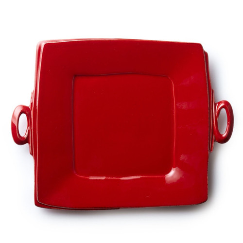 "Long lauded for creating one of the best shades of red in tabletop, we are thrilled to announce our newest red. Lastra's iconic cheese mold shape meets the rich hue, and the result is extraordinary on this Lastra Red Handled Square Platter. 13""Sq LAS-2628R"