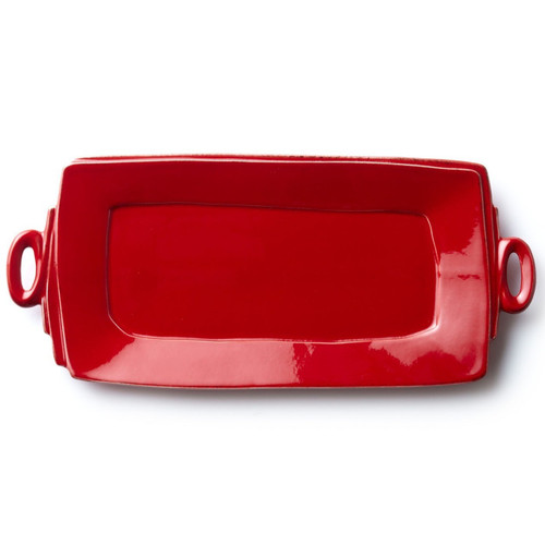 "Long lauded for creating one of the best shades of red in tabletop, we are thrilled to announce our newest red. Lastra's iconic cheese mold shape meets the rich hue, and the result is extraordinary on this Lastra Red Handled Rectangular Platter. 16""L, 8.75""W LAS-2623R"