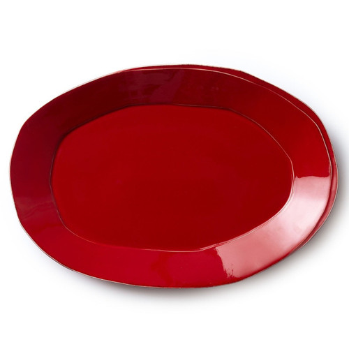 """Long lauded for creating one of the best shades of red in tabletop, we are thrilled to announce our newest red. Lastra's iconic cheese mold shape meets the rich hue, and the result is extraordinary on this Lastra Red Oval Platter. 18.5""""L, 12.5""""W LAS-2626R"""