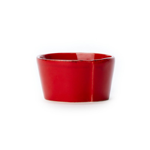 "Long lauded for creating one of the best shades of red in tabletop, we are thrilled to announce our newest red. Lastra's iconic cheese mold shape meets the rich hue, and the result is extraordinary on this Lastra Red Condiment Bowl. 4""D LAS-2603R"