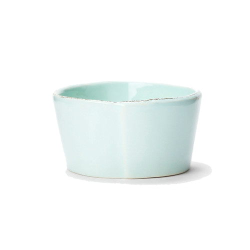 "The rustic yet chic shape of the Lastra Aqua Condiment Bowl looks clean and sophisticated on your table. An overlapping wooden mold, used for centuries to form cheeses throughout Italy, inspired this collection. 4""D LAS-2603A"