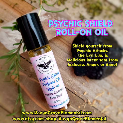 PSYCHIC SHIELD PERFUME OIL crafted by Ravyn Grove Elemental - Shield yourself from Psychic Attacks, the Evil Eye, & Malicious Intent sent from Jealousy, Anger, or Rage! Crafted using protective and shielding Angelica, Rosemary, Lily, Nettle, and Anise oils and herbs!. Front.