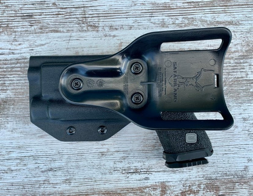 Glock 17 with OLight Pro Light Bearing Drop Holster