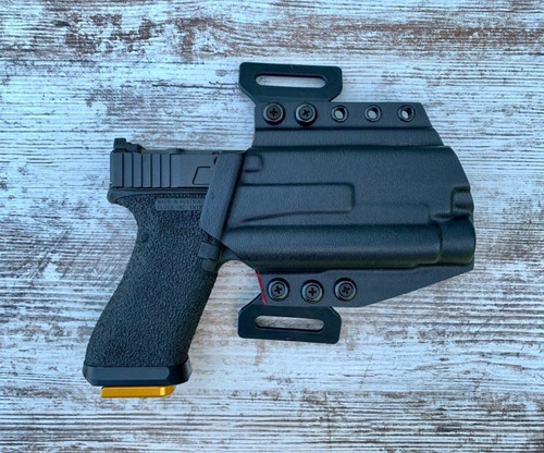 Glock 17 with OLight PL Pro Outside Waistband Holster