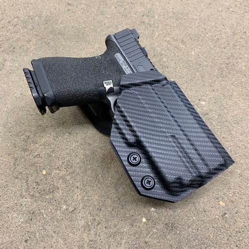 Glock 19/23 w/ OLight Mini 1 Light Bearing Outside Waistband UBL Drop Holster