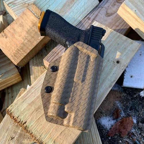 Glock 34 w/ OLight PL Pro Outside Waistband Holster