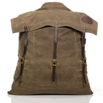 Old No.3 Canoe Pack No.753 by Frost River. A big, field tan waxed canvas backpack with leather straps and solid brass buckles and hardware.